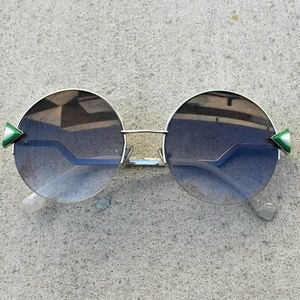 34d1fe02767f Accessories - Large round sunglasses with triangle stones